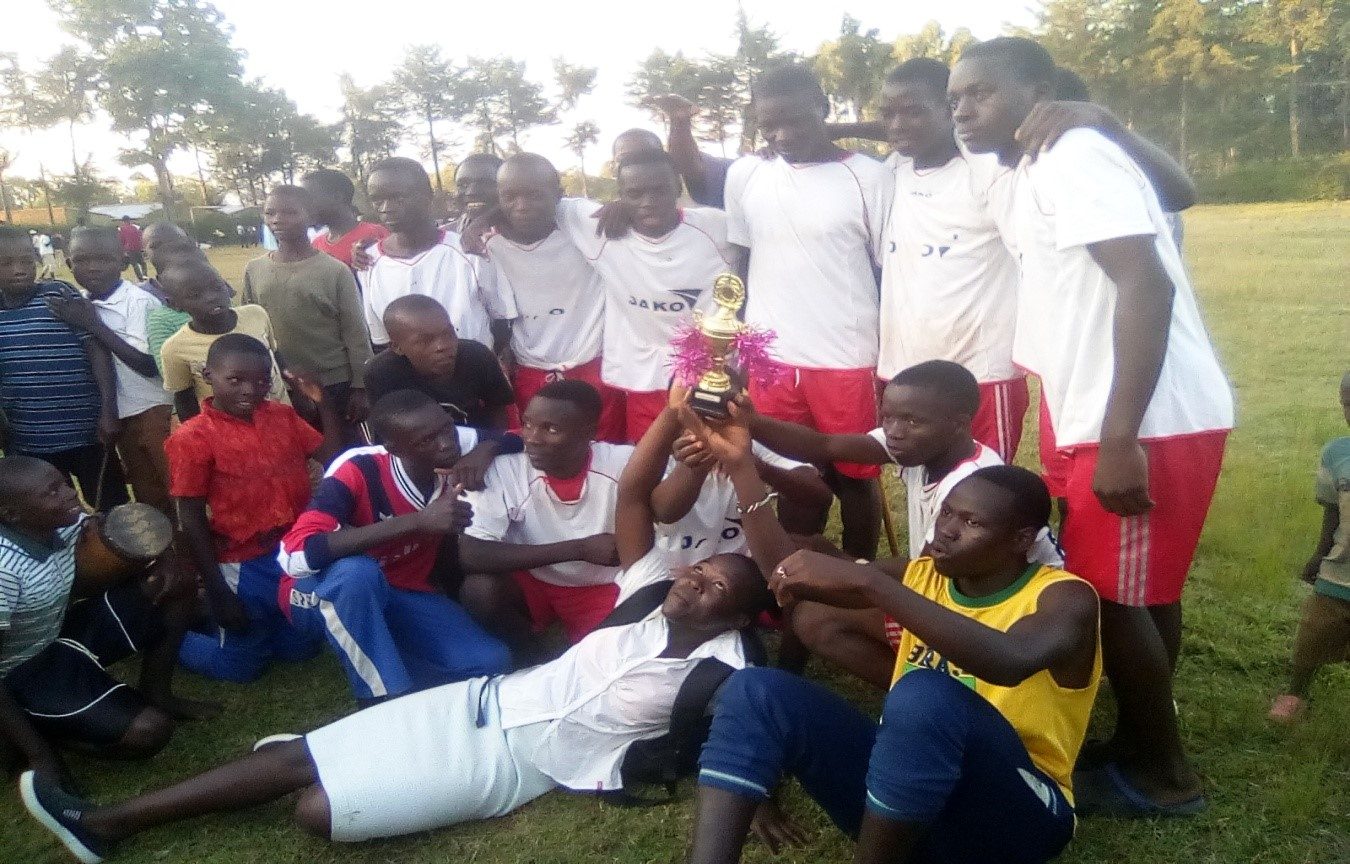 Malaika Children Team with the trophy as the winner for the Tournament